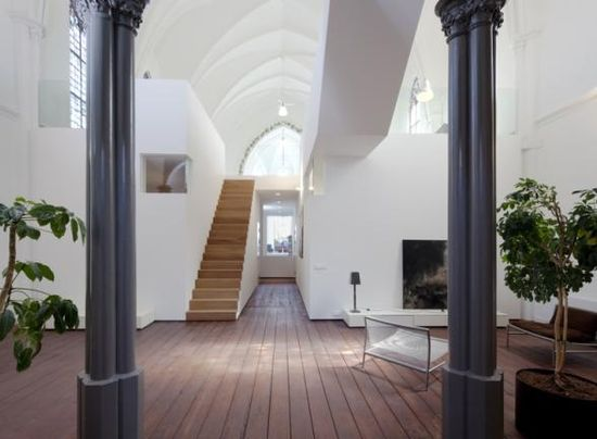 Old Dutch church converted into a beautiful house - View of staircase leading to second level -  by Zecc Architects