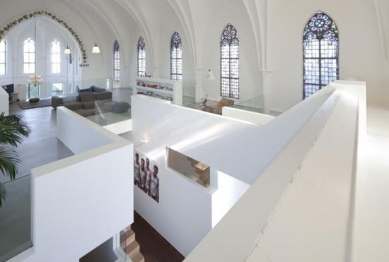 Old Dutch church converted into a beautiful house - View of downstairs area from second level -  by Zecc Architects