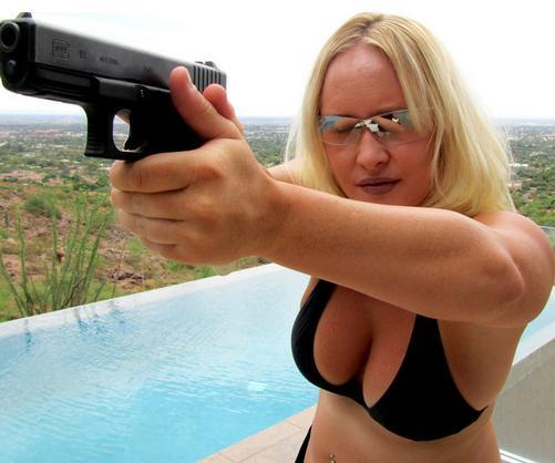 A Bikini-clad Glock honeypot aims her gun proudly