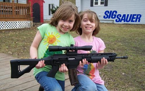 Glock owner proudly takes picture of his two young daughters holding his Glock semi-automatic scoped assault rifle. Just what you need to go deer hunting