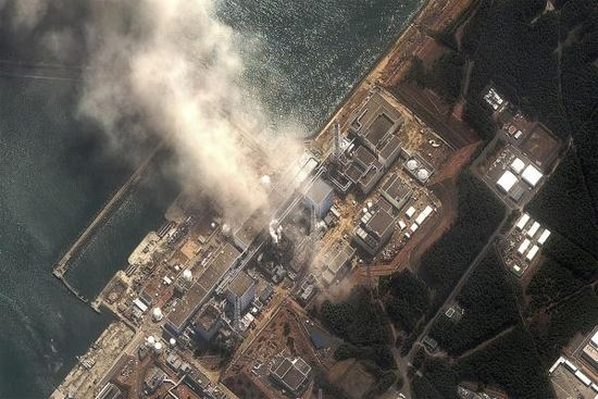 Plumes of smoke and steam emit from the nuclear reactors at Fukushima Japan