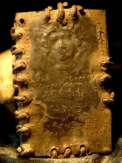 Engraving of what appears to be the face of Jesus engraved on 2000 year old lead books bround in wire