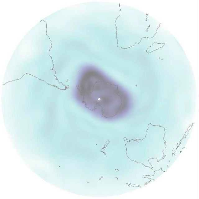 Overhead of spinning gray vortex situated over the South Pole in Antarctica