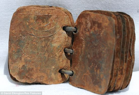 One of 70 ancient little books with lead pages bound with wire is opened to reveal engravings that could unlock secrets of ancient Christianity