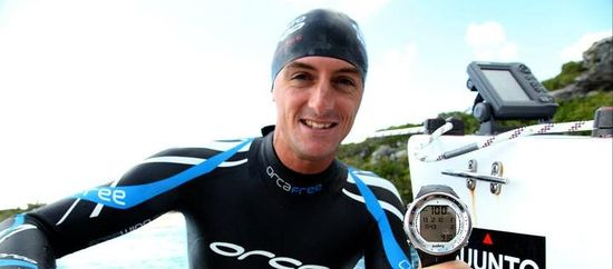 William Trubridge, World's No-Fin Free Diving Champion, holds depth meter showing he record setting 101 meters or 331 feet dive at Dean's Blue Hole