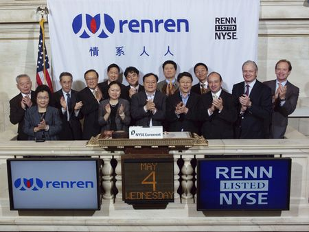 RenRen's CEO Joseph Chen in the middle, executive team, US investment bankers and NYSE officials at the NYSE IPO ceremony on Wednesday, May 4, 2011