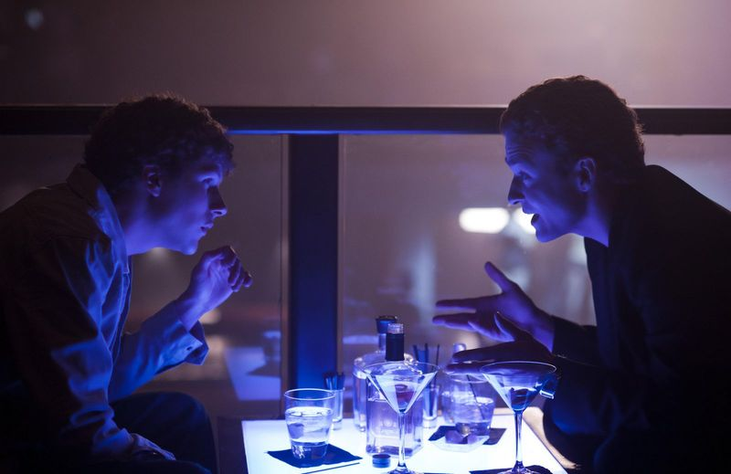 Scene from the Social Network with Sean Parker telling Mark Zuckerberg that you are only cool if you are a billionaire