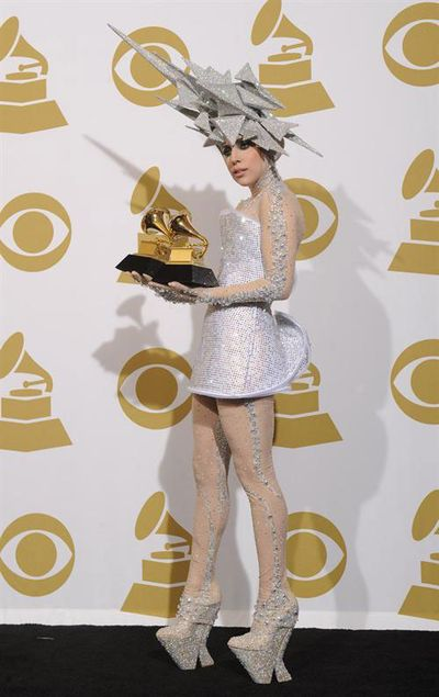 Lady Gaga wears layered trapezoid head piece with matching outfit with her Grammy award