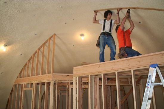 The Hobbit House interior wooden studs being built