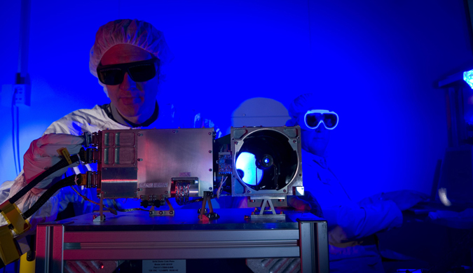 Scientist working with ChemCam, to detect trades of life on Mars