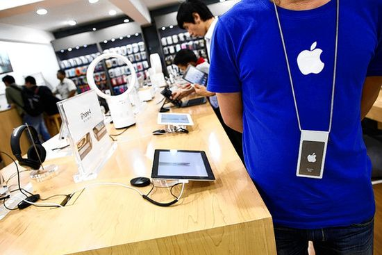 Fake Apple Store in Kunming China salesrep ready to attend to customers, notice fake blue Apple T-shirt