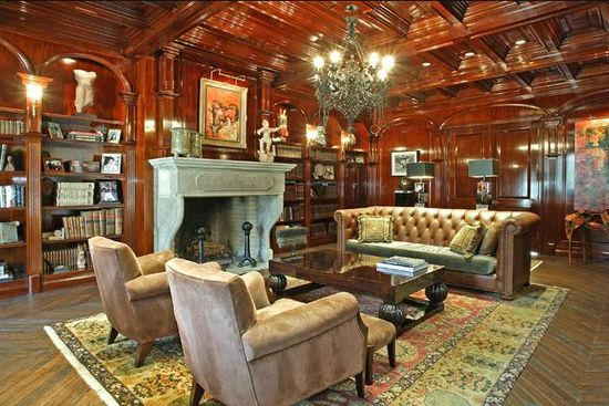 Feldman Chateau in Englewood, N.J.library and reading room decked out in French Cherrywood wall-to-ceiling molding