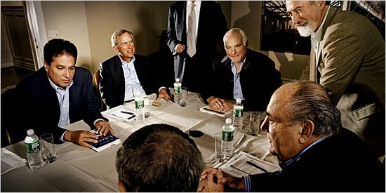 Michael Sonnenfeld (Seated Center) is the founder of Tiger 21, The guy in the far left is N.Y. real estate magnate Ziel Feldman