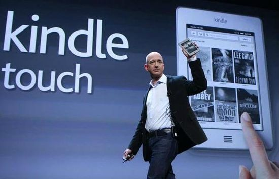 Amazon CEO Jeff Bezos holds new Kindle Touch eReader at today's product launch in New York