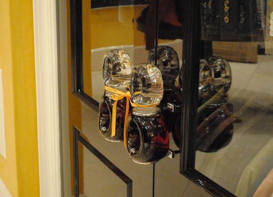 Bijan boutique closets feature perfume bottles as handles