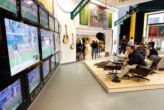 New York's MLB's Fan Cave where MLB fans watch 2,454 MLB games of the 2011 season from inside a transparent room