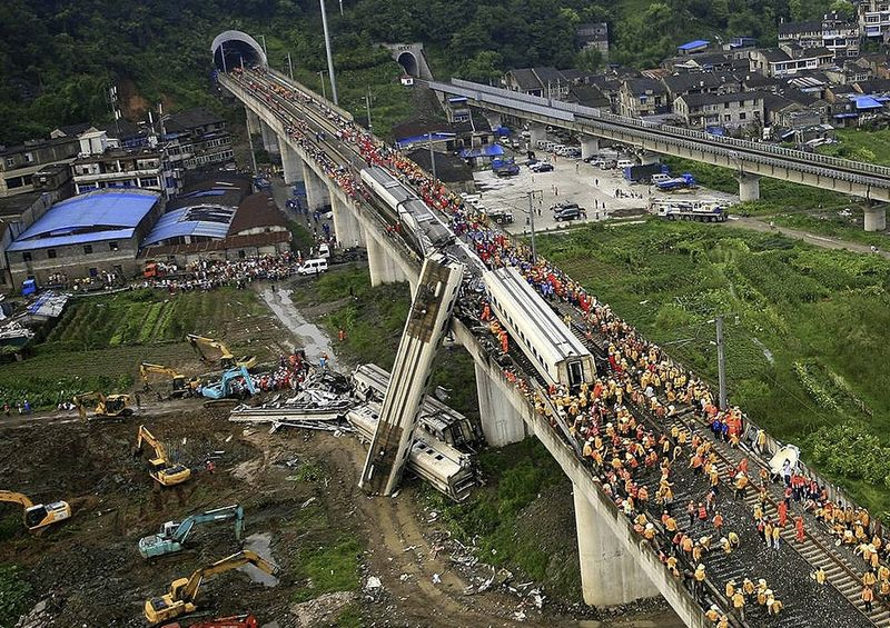 The Chinese bullet train accident killed 40 people and injured at least 190. The impact sent four carriages plunging 65 ft off the elevated rail line.