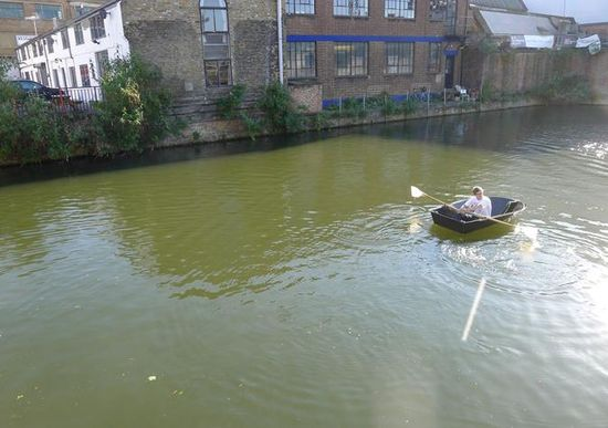 Floatboat being rowed in a canal in London 2