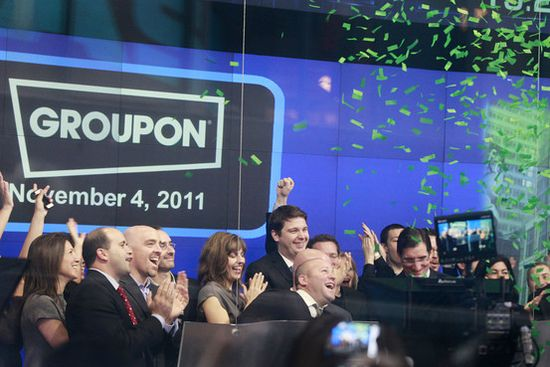 Groupon CEO (Center back row) Little Andy Mason, executive team and staffers cheer their IPO as the opening bell of NASDAQ rings to begin trading Groupon shares