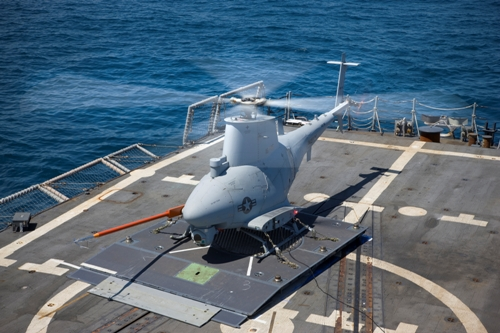 MQ-8B Fire Scout conducting tests from the rear heliopad of a U.S. Navy ship