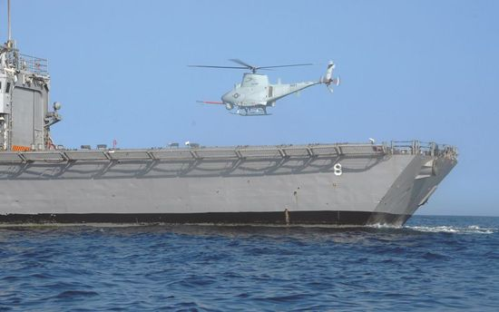 MQ-8B Fire Scout unmanned aerial vehicle hovers over the flight deck of the guided-missle frigate USS McInerney FFG-8