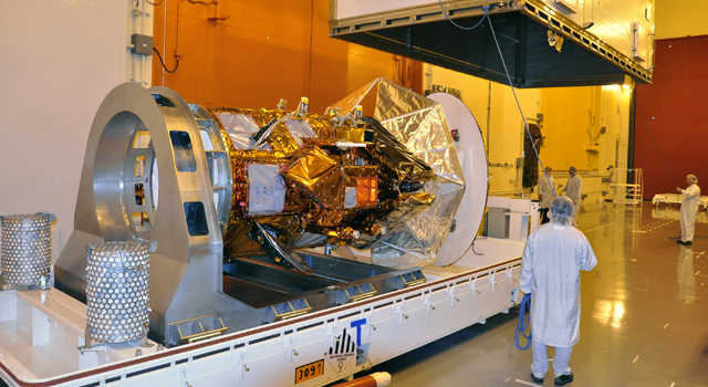 The Aquarius SAC-D spacecraft is unpacked and unveiled in the Spaceport Systems International payload processing facility at Vandenberg Air Force Base in California on April 6, 2011