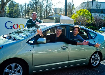 Google driverless car with Executive Chairman Eric Schmid, CEO and co-founder Larry Page and co-founder Sergey Brin