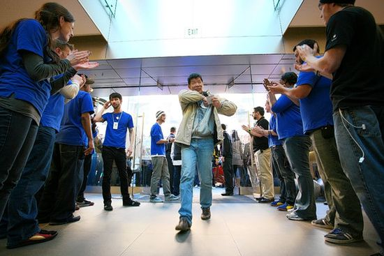 When a new product is launched, such as the second-generation iPad in March, employees cheer customers as they enter and exit the store