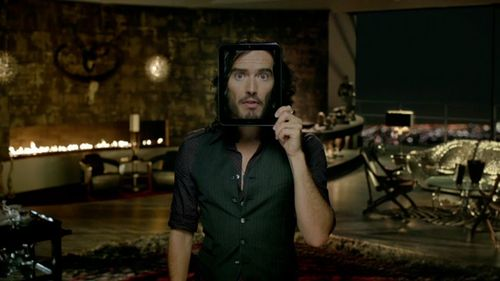 Russell Brand holding an HP TouchPad