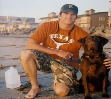 First class petty officer Jon T. Tumilson with his dog Hawkeye