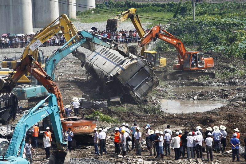 The Chinese bullet train accident killed 40 people and injured at least 190. The impact sent four carriages plunging 65 ft off the elevated rail line 3.