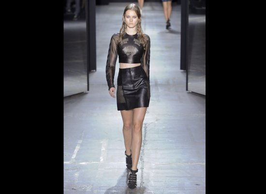 Black leather two-piece leather outfit with bare mid