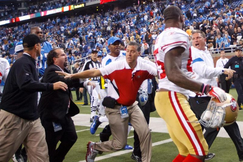SF 49ers head coach Jim Harbaugh (left) and Detroit Lions head coach Jim Schwartz in near altercation to due 'hard' handshake by Harbaugh
