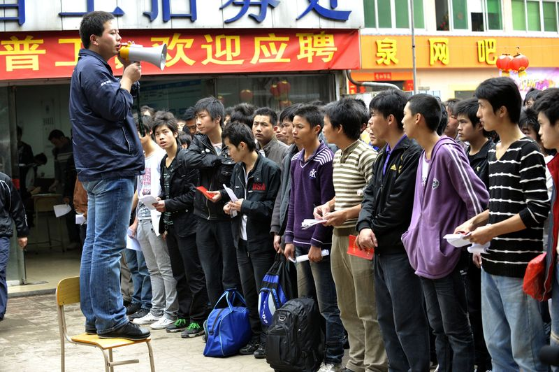 Foxconn International worker recruiter belches out, 'Now listen up punks, we are paying you 2.25 yuans, not the usual 2.00 yuans per day, to keep your mouth shut about Apple. Got that'