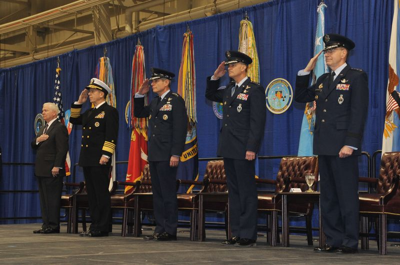 Secretary of Defense, Robert Gates, and Joint Chiefs of Staff of the the four branches of the U.S. Military salute the dedication of USSTRATCOM and USCYBERCOMMAND on May 21, 2010