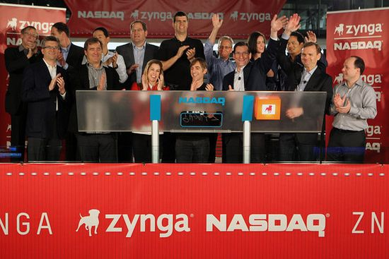 Mark Pincus (short dude next to blonde in middle of pic) is founder and CEO of Zynga, beams with joy before his company stock dropped 5 pts on 1st day of trading
