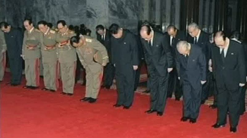 Kim Jong Un ( fourth from right) bows to his deceased father