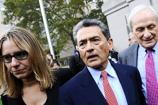 Rajat Gupta, center, former Goldman Sachs director, exits federal court in New York on Wednesday.