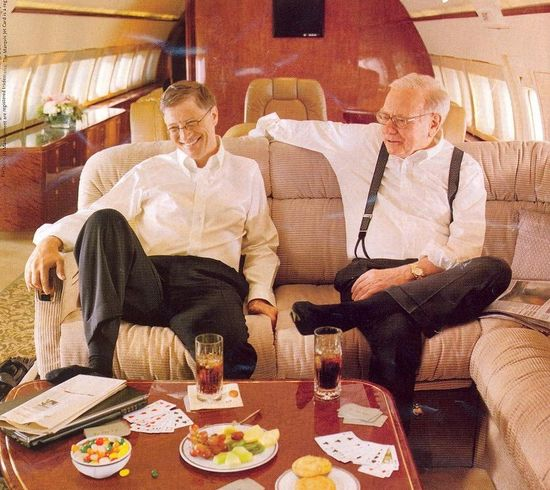 Bill Gates and Warren Buffett on board Berkshire Hathaway corporate jet