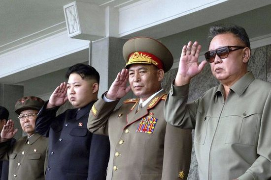 Kim Jong Il, far right, and Kim Jong Eun, third from right, salute while watching a military parade in September.