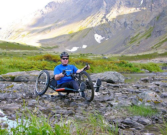 ATH All-Terrain Handcycle maneuving through rocks and small streams