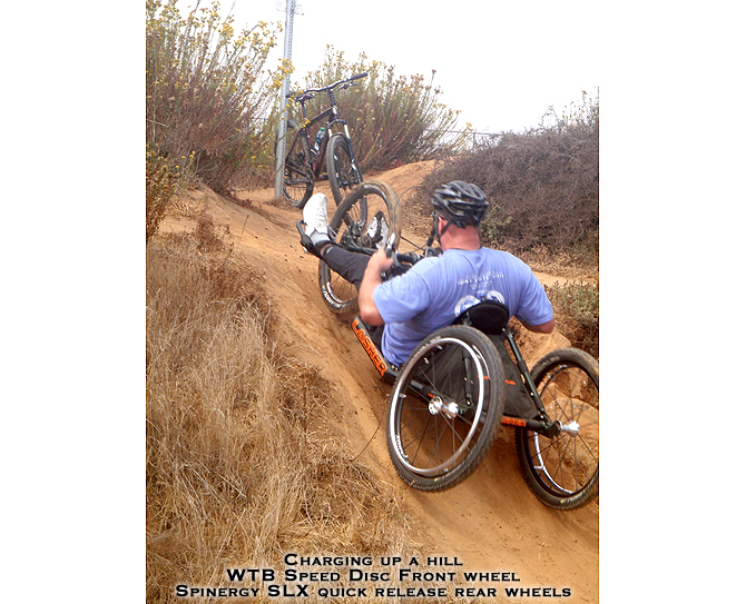 ATH All-Terrain Handcycle being ridden off-road on a dirt trail
