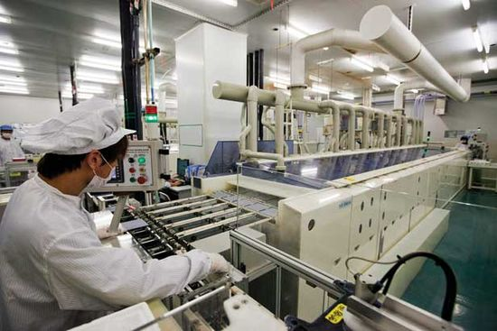 At a factory in Wuxi, China, a machine that uses a novel process developed by Suntech Power etches the surface of crystalline silicon wafers for solar cells.