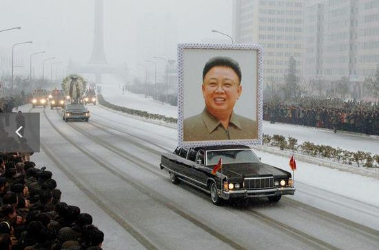 A car carried Kim Jong Il's portrait during his funeral procession.
