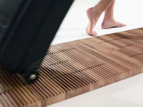 Jeriël Bobbe's Me-Lo-Dy Musical Floor has ridges that play musical tones when a carry-on luggage is carried accross them