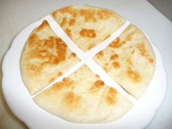 Freshly baked pita bread, with some gresh garlic rubbed on it and olive oil, hmmm