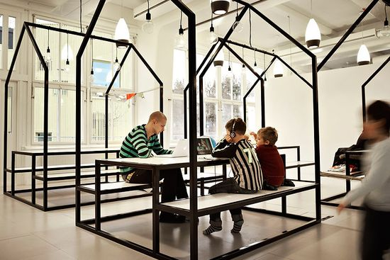 Vittra Telefonplan School has small houses called 'The Village' that create rooms for working in smaller groups by Swedish design firm Rosan Bosch