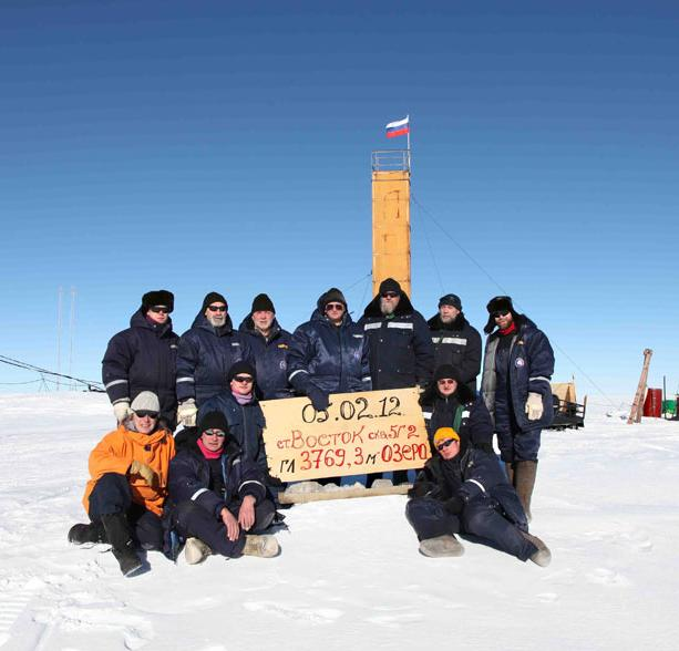 Russian scientists pose for group photo after their drill hole successfully reached Lake Vostok on February 5, 2012