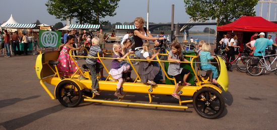Dutch kindergarden students pedaling their bus to school