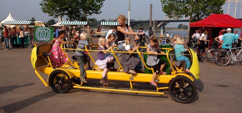 Dutch kindergarden students pedaling their bus to school